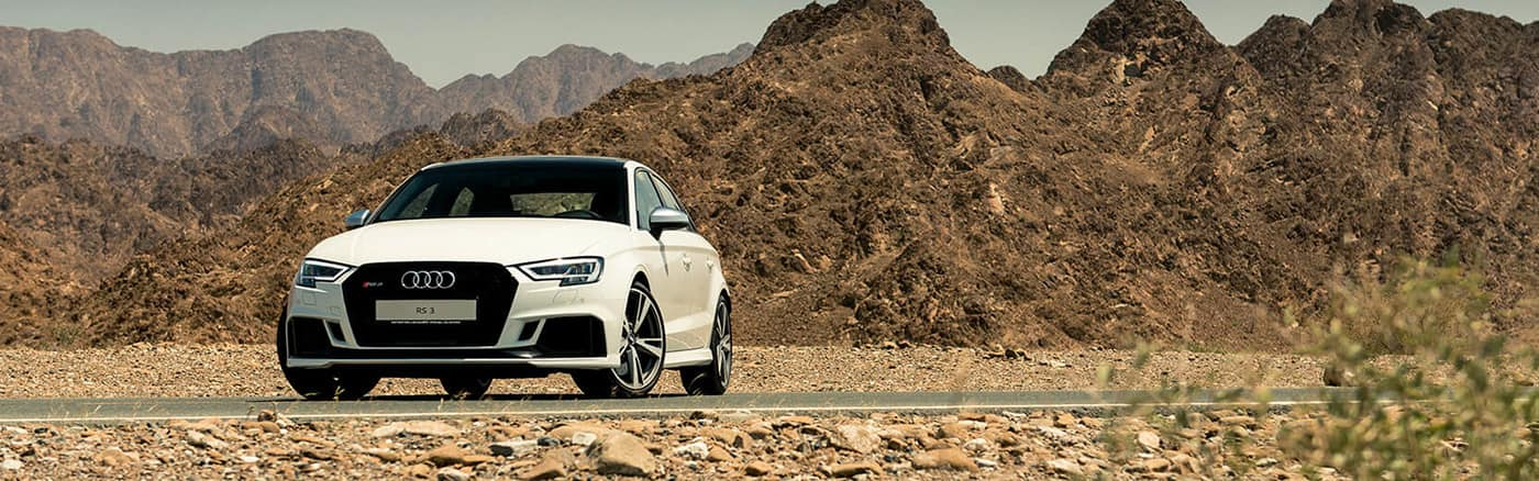 rs3_sedan_dennis_white_1400x438_front_desert.jpg