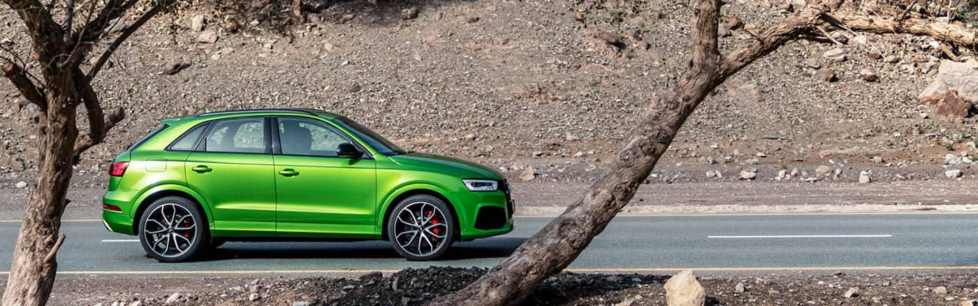 RSQ3_audi_SUV_green_side_trees_1400x438.jpg
