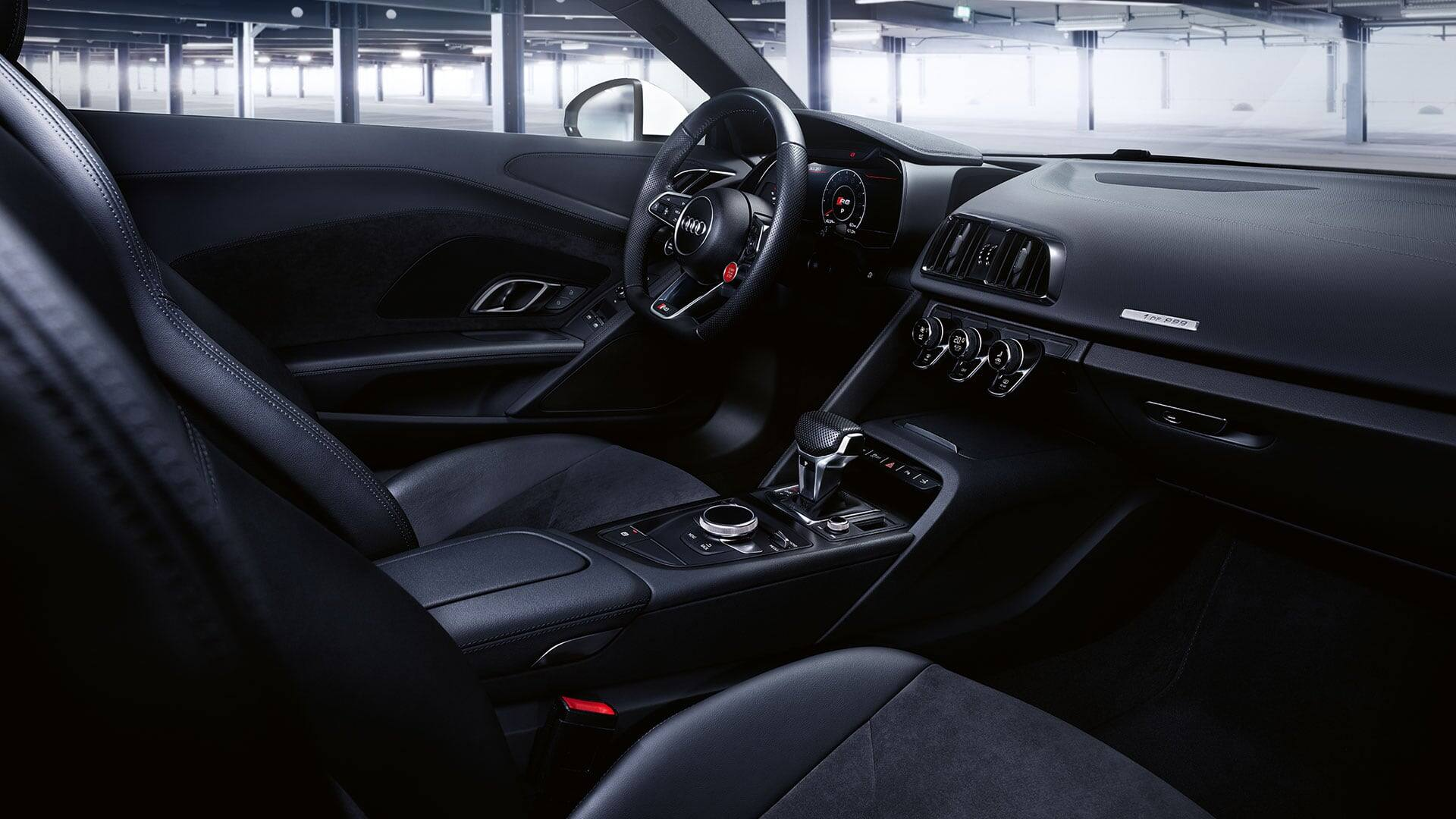 The optional R8 performance leather steering wheel and the standard R8 sports seats intensify that feeling of racing in the Audi R8 Coupé V10 RWS on top.